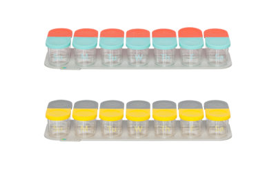 Sagely weekly pill organizer in coral and red and yellow and gray